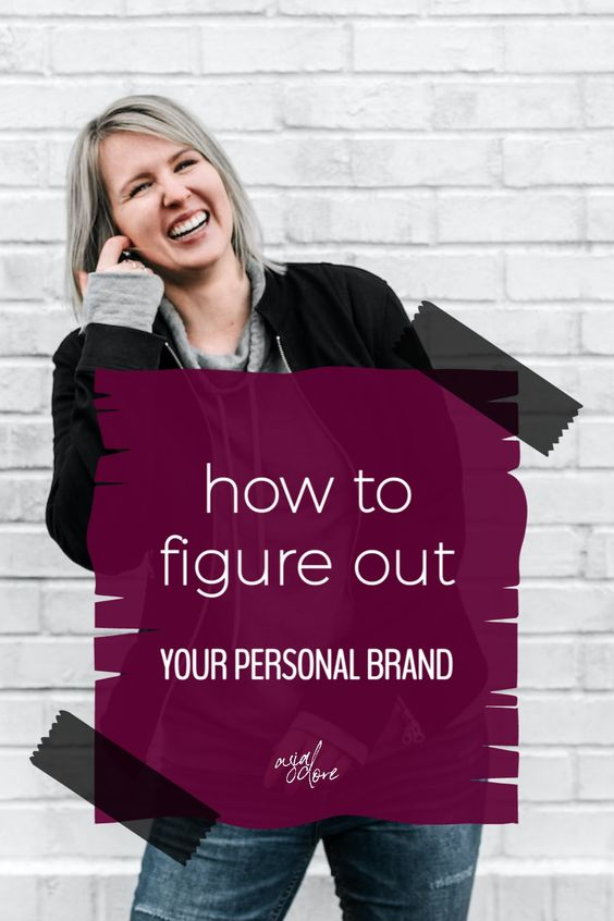 Blonde woman in a black jacket laughing in front of a white brick wall with text - how to figure out your personal brand