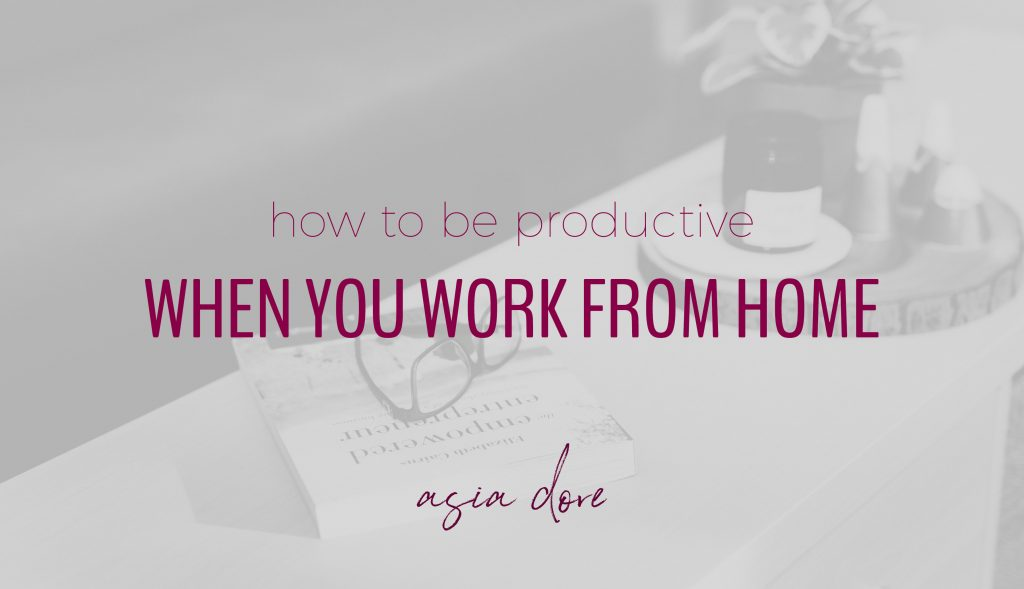 A book, glasses, candle, and plant laying on a desk with text - how to be productive when you work from home