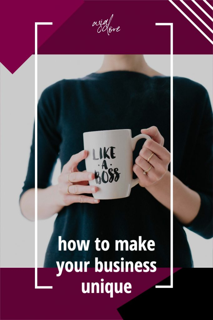 """A woman holding a mug that says """"like a boss"""" with text - how to make your business unique"""