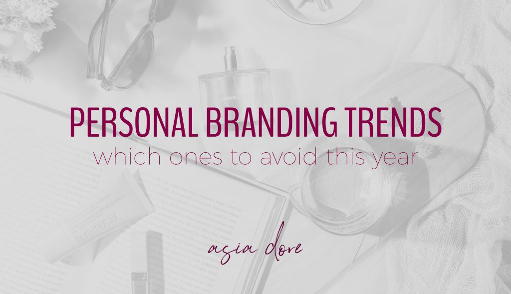 A sunny flat lay with sunglasses, perfume, makeup, a book, and a glass of wine with text - personal branding trends, which ones to avoid this year